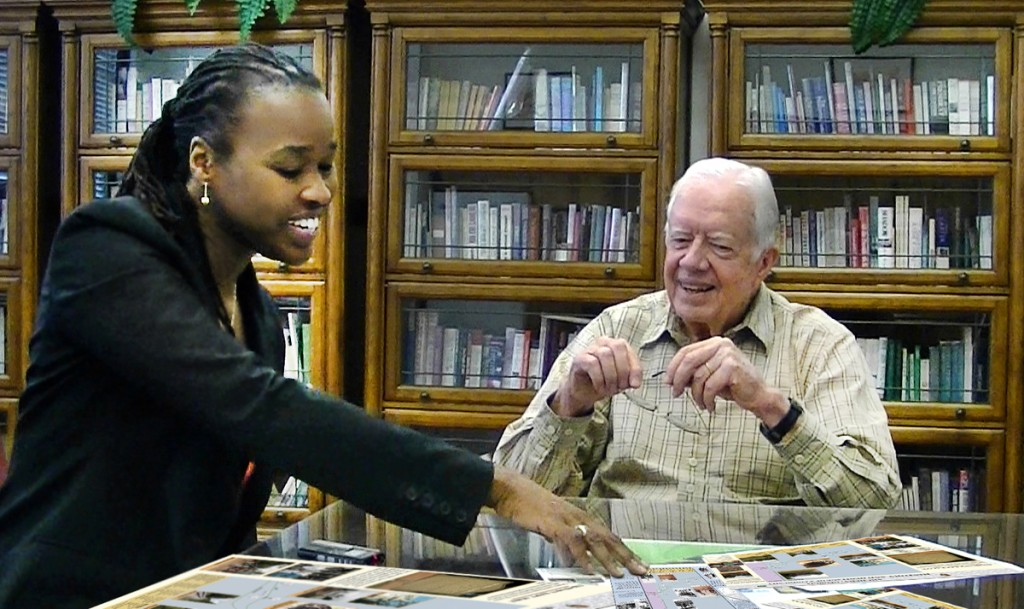 Antoinette Jackson talks with former president Jimmy Carter about the nearly vanished town of Archery, which occupied part of Carter's boyhood farm.