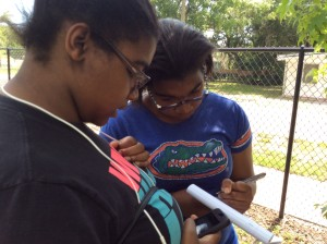 Teens map coordinates (latitude and longitude) of their geocache using the geocache iPhone app.